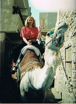 Patti Morrow rides a camel through the streets of Cairo, Egypt.