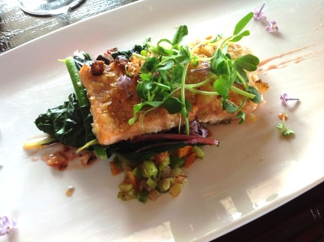 Dining on crusted trout at Willow on Wascana Lake in Regina, Saskatchewan.