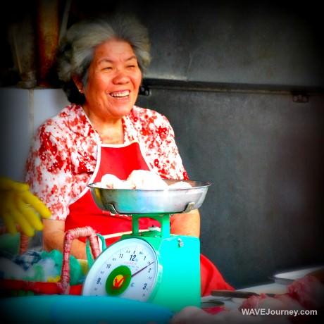Woman Meat Market Vendor