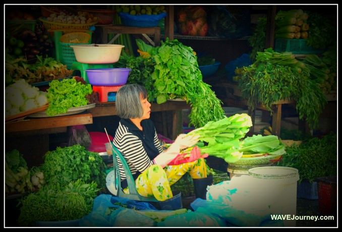Woman Selling Vegetables in Saigon