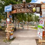 Wish You Were Here – Postcard From Watson Lake, Yukon - Sign Post Forest