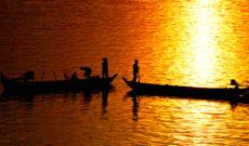 Fishermen on the Mekong River at Sunset