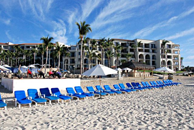Yoga by the beach at Dreams Los Cabos Suites Golf Resort & Spa