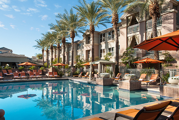 Courtyard Heated Pool Lined With Palm Trees