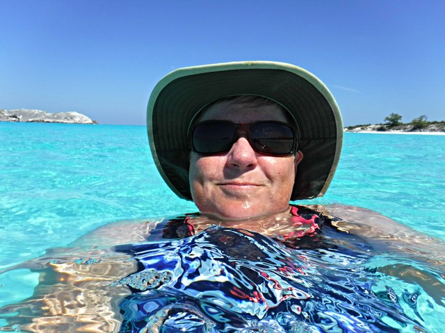 Viv Takes a Dip in the Sea at Crescent Beach on Compass Cay