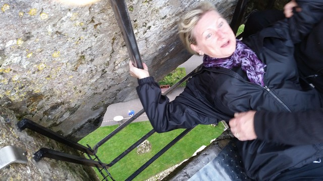 Barb Dodge kissing the Blarney Stone. Photo by George Dodge.