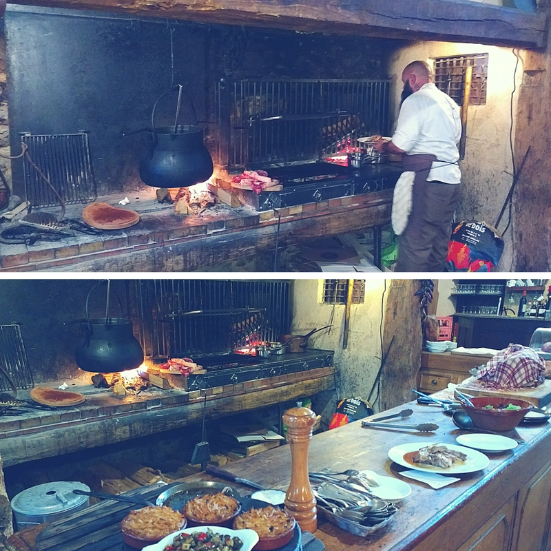 Chef Laurent cooks over a wood fire.